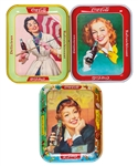 "Vintage 1950-61 Coca-Cola Canadian Serving Tray Collection of 10 Including 1950 ""Red Hair Lady"", 1953 ""Menu Girl"" and 1957 ""Umbrella Girl"""