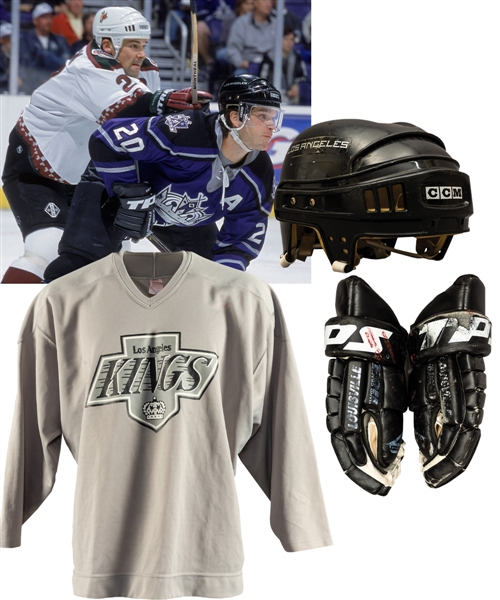 Luc Robitailles Los Angeles Kings Early-2000s TPS Game-Used Gloves, Circa 2000 CCM Game-Worn Helmet, 1990s Practice Jersey and Game Sticks (3) with His Signed LOA